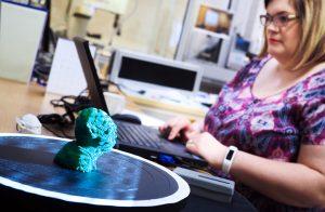 Automation lab staff 3D printing Yoda's head.