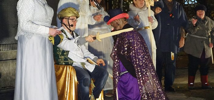 Eight people perform a Christmas play