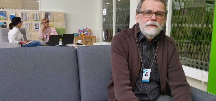 Tapio Myllymaa sits on a sofa in SAMK's Pori campus library