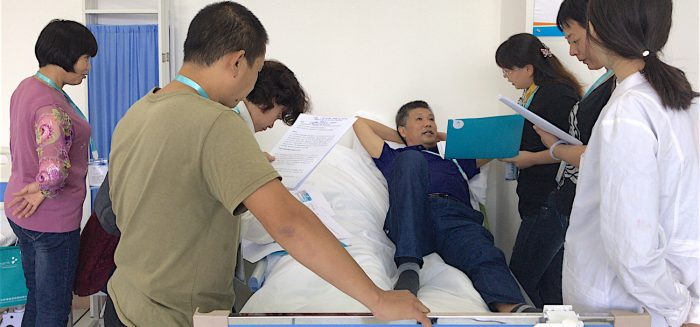 People practicing the situation in a hospital