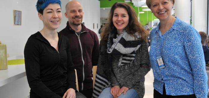 Elina Pettersson, Matthias Rigal, Lea Heinrich and Maija Kangasperko are posing for the camera on SAMK's Pori campus.