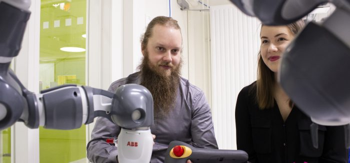 Students working with Yumi-robot at SAMK-campus Pori automation lab.