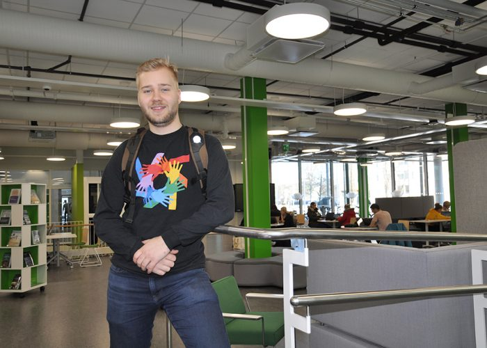 Tourism student Topias Myllynen at SAMK campus Pori library.