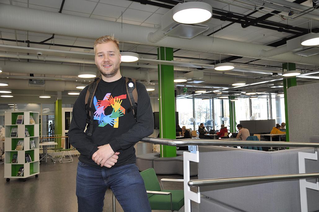 Tourism student Topias Myllynen at SAMK campus Pori library.