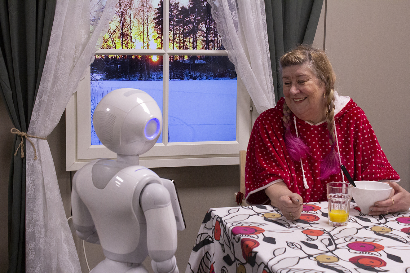 Pepper robot hanging out with senior.