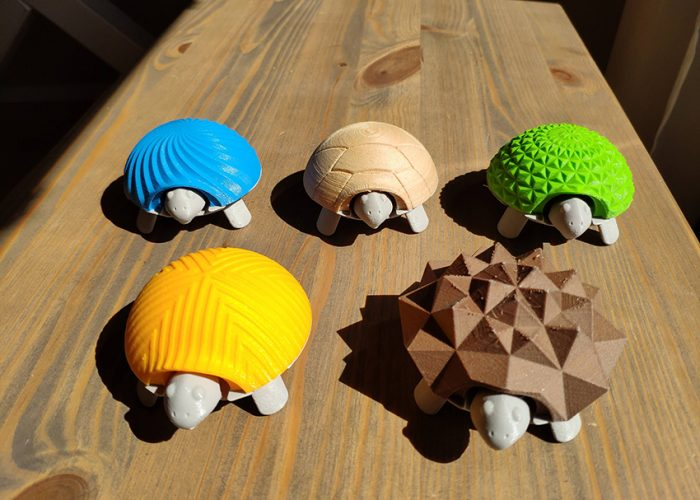 Colourful 3D printed turtles.