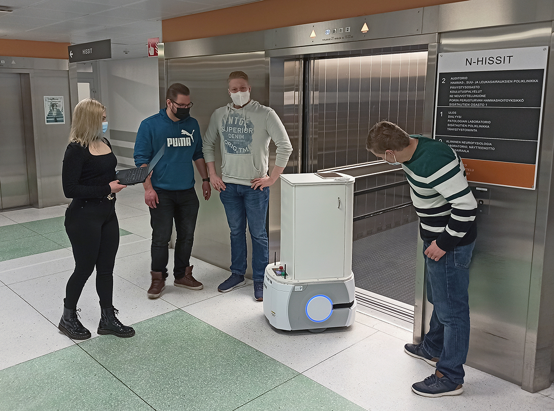 In the picture students use manual control to get the mobile robot into the lift.