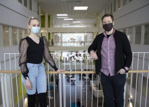 In the picture, Vilhelmiina and Ollipekka are posing at the Pori campus.